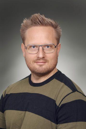Porträttfoto av Fredrik Lundin