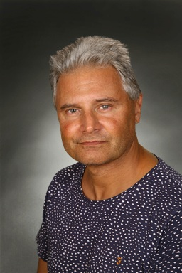 Porträttfoto av Marek Komorowski