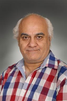 Porträttfoto av Nader Sani
